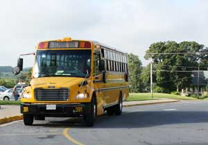 School Bus Arriving to drop kids off at school.