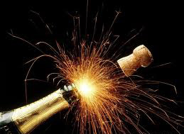 Champagne bottle blowing its cork.