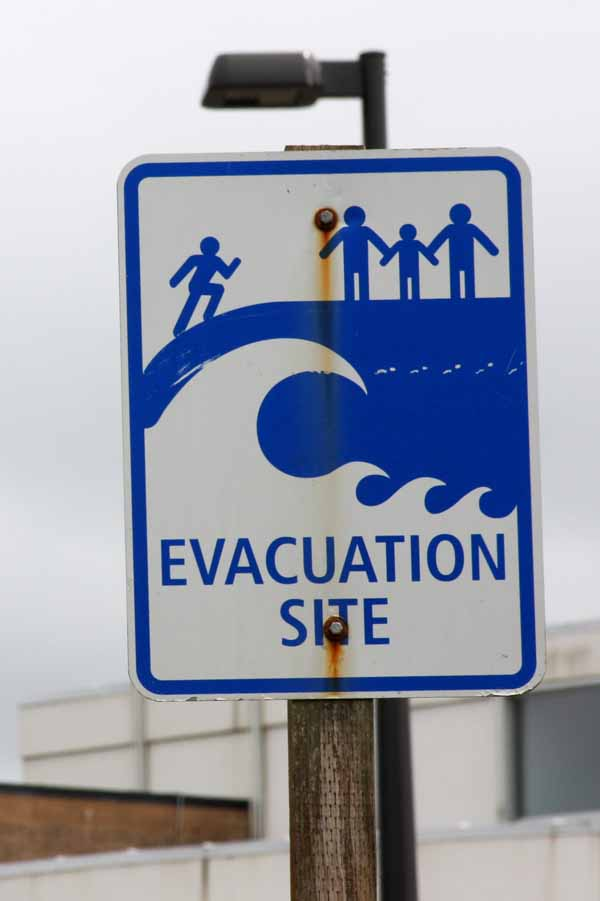Photograph of a sign which reads: Evacuation Site