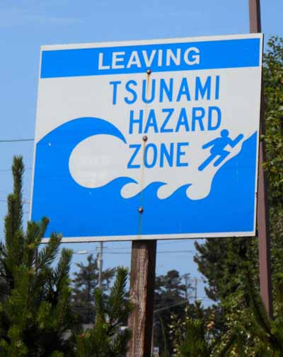 Photograph of a sign which reads: Leaving: Tsunami Hazard Area