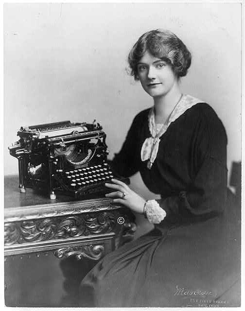 Woman Seated beside Underwood Typewriter.  Photo Courtesy of Library of Congress. Permalink: http://lccn.loc.gov/2003654903