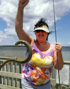 Kelly A. Harmon and an Eel she caught.
