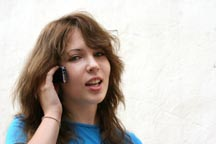Teenaged girl talking on a cell phone.